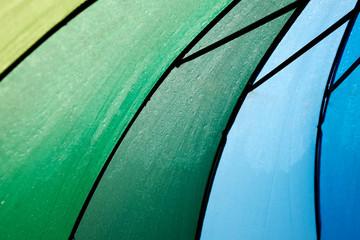 A close up shot of Rainbow coloured umbrella