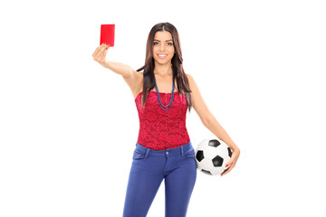 Female football fan showing a red card
