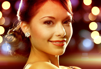 woman in evening dress wearing diamond earrings