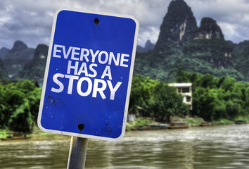 Everyone Has a Story sign with a exotic background