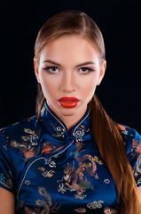 Young beautiful girl in oriental dress