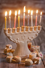 Jewish holiday hannukah symbols - menorah and wooden dreidels