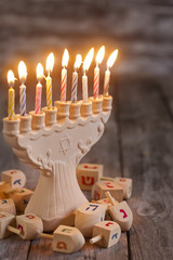 Jewish holiday hannukah symbols - menorah and wooden dreidels. C