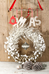 White Christmas wreath on brown wooden vintage background