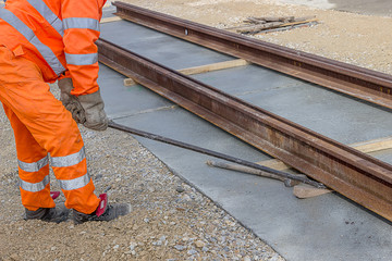 Align piece of railroad track before welding