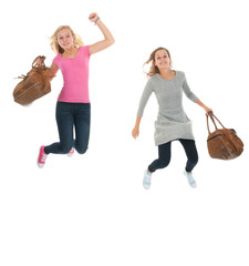 Jumping youth with school bags