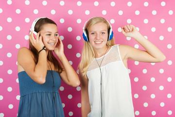 Teenager girls with headphones