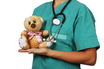 Pediatrician with stethoscope and teddy bear
