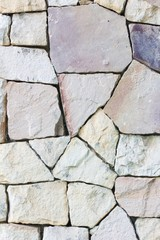 Multi-colored and multi-sized, pale rocks wall grunge texture ba