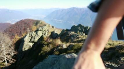 Climber's hands holding rocks
