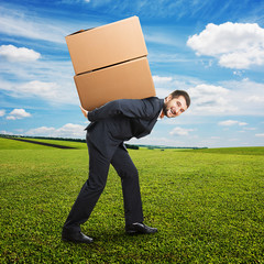 businessman holding packages on the back
