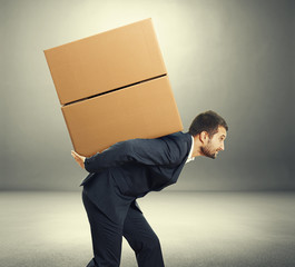 man carrying two heavy boxes