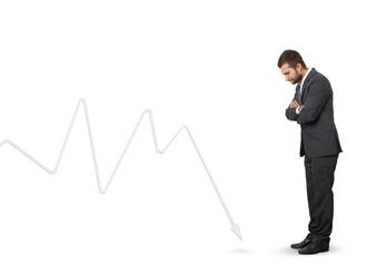 man looking at downturn graph
