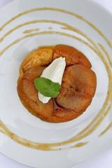 Tatin tart with vanilla cream, mint and apple sauce
