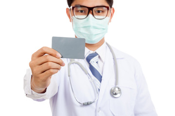 Asian male doctor wear mask with blank card