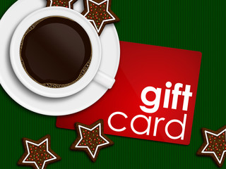 christmas coffee, gingerbread and gift card lying on tablecloth