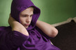 Depressed teenager with arms around his neck and hood on head - 72956005