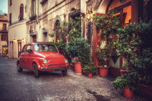 """Постер, картина, фотообои """"Old vintage cult car parked on the street by the restaurant, in"""""""