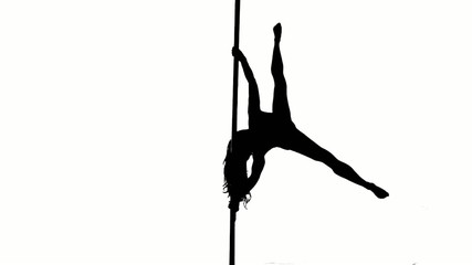 One caucasian woman pole dancer dancing in silhouette studio
