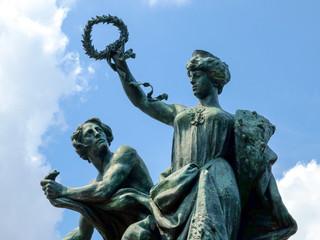 Classic bronze statue closeup with blue sky background