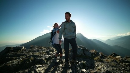 Proud hikers celebrating on mountain summit