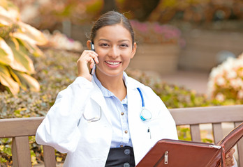 smiling female doctor healthcare professional talking on phone