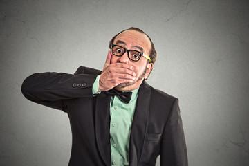 Shut up, keep corporate deals secret, man covers mouth