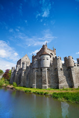 Gravensteen castle reflecting in river, Belgium