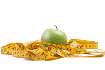 healthy diet concept ,apple and a measuring tape on wooden table