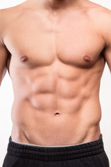 Muscular man body with six pack
