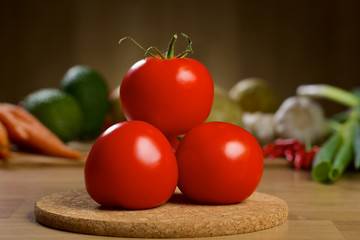 Red tomatoes on the wooden table