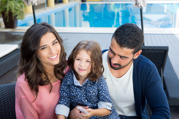 Family close to the pool