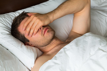 Man Covering Eyes with Hand