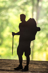 cut out of hiking man silhouette over nature background