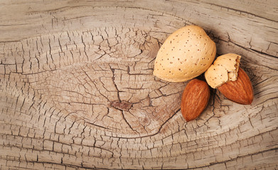 Almonds on old wooden background
