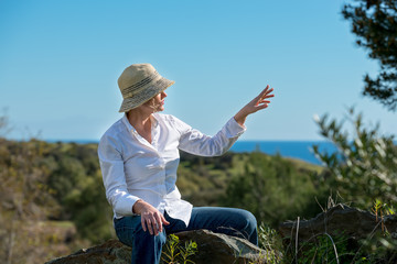 Woman in nature pointing away