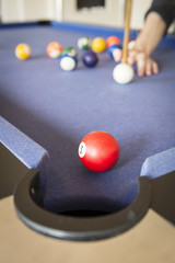 Playing Pool on Pool Table