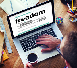 Man Reading the Definition of Freedom