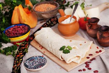 Indian thin pita bread on a board still life