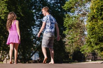Teen Boy Girl Walking Away Talking
