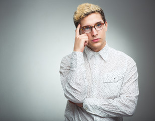 Young man with glasses thinking