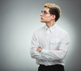 Young serious man in glasses in profile