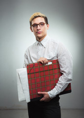Young serious man in glasses with a drawing folder in hands