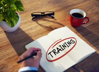 "Businessman Writing the Word ""Training"""