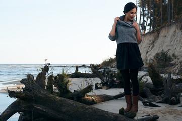 brunette on sea coast in autumn