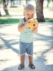 Baby with wicker ball