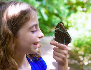 Girl holding finger Blue Monrpho Butterfly Peleides