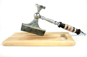 Kitchen axe on wooden board