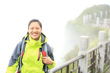young woman hiker enjoy the view at emei mountain peak