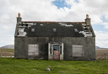 Old abandoned house in the countryside with broken roof